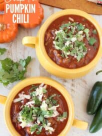 Overhead image of pumpkin chili in yellow bowls topped with shredded cheese and cilantro