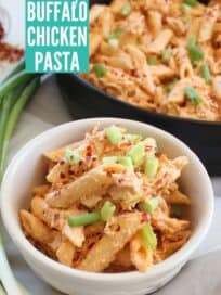penne pasta in cheesy sauce in bowl