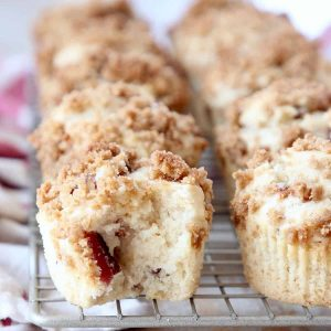 Maple Bacon Muffins on wire rack with bite of muffin taken