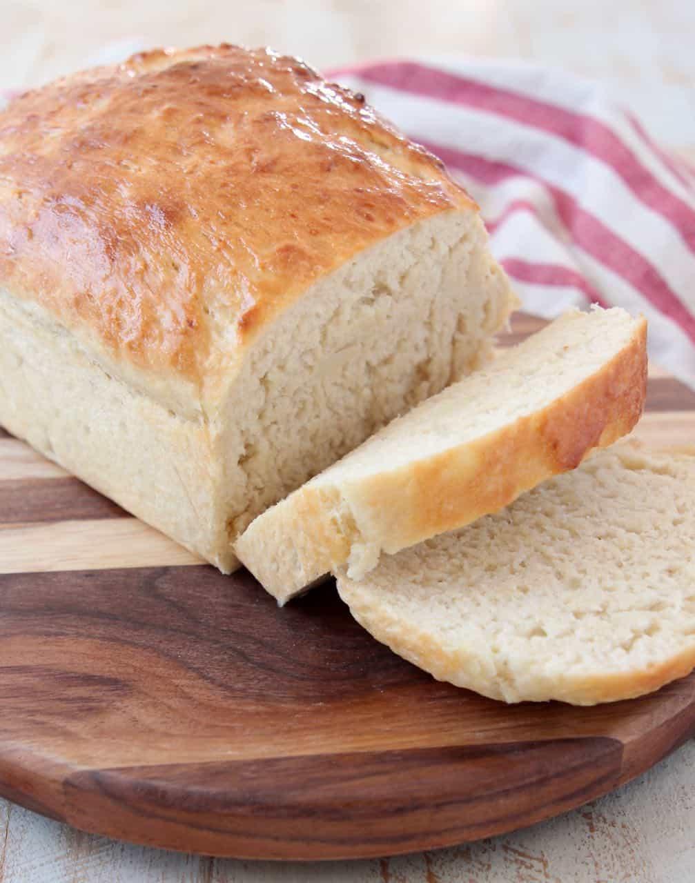 Sliced loaf of potato bread on cutting board