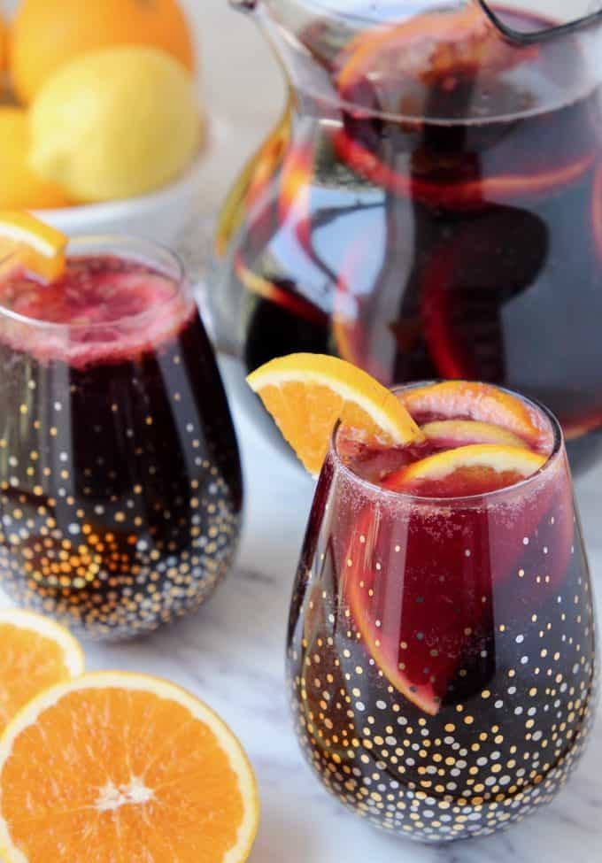 Red sangria in glasses and pitcher