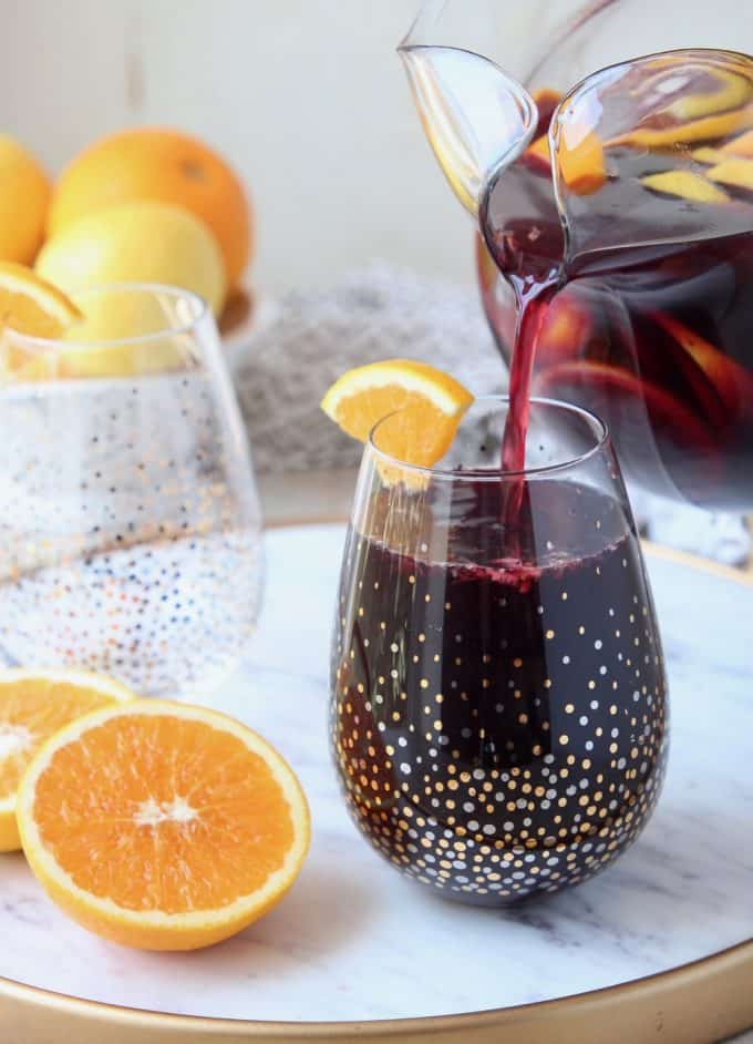 sangria poured into glass from pitcher