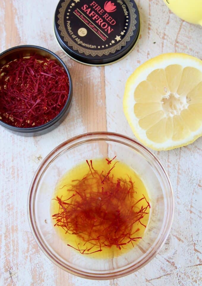 saffron threads soaking in lemon juice in bowl