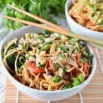 Thai peanut noodles in bowl with chopsticks on the side