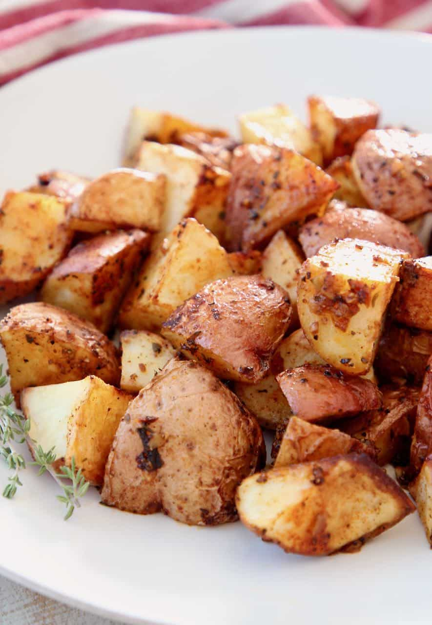 Roasted cubed potatoes on white plate