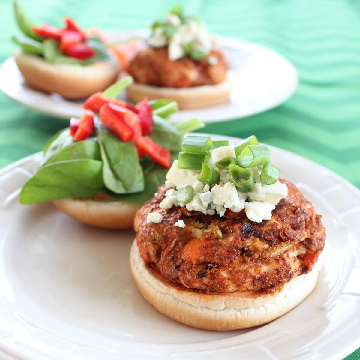 ... buffalo chicken burger topped with blue cheese, green onions and a