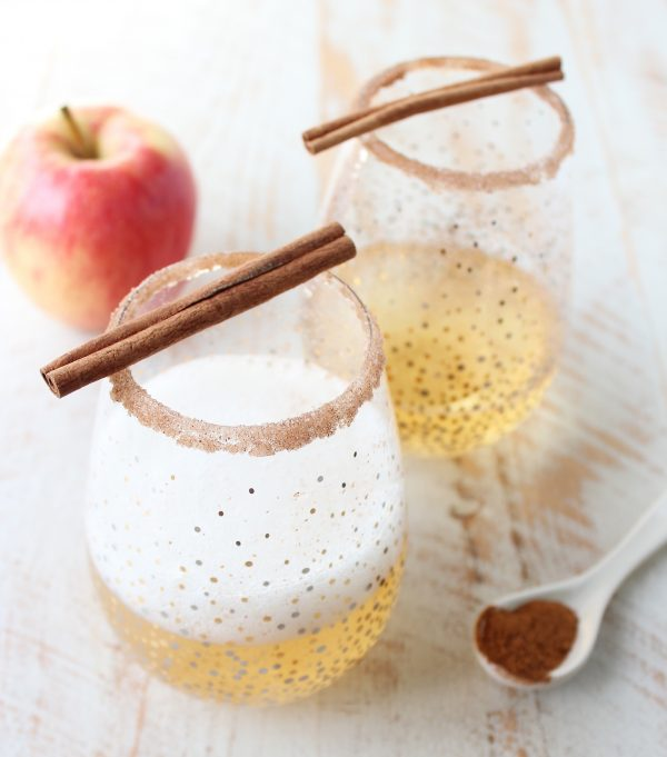 Rich apple cider is paired with sparkling champagne, vodka, maple syrup, cinnamon and nutmeg to make a festive fall apple cider champagne cocktail!