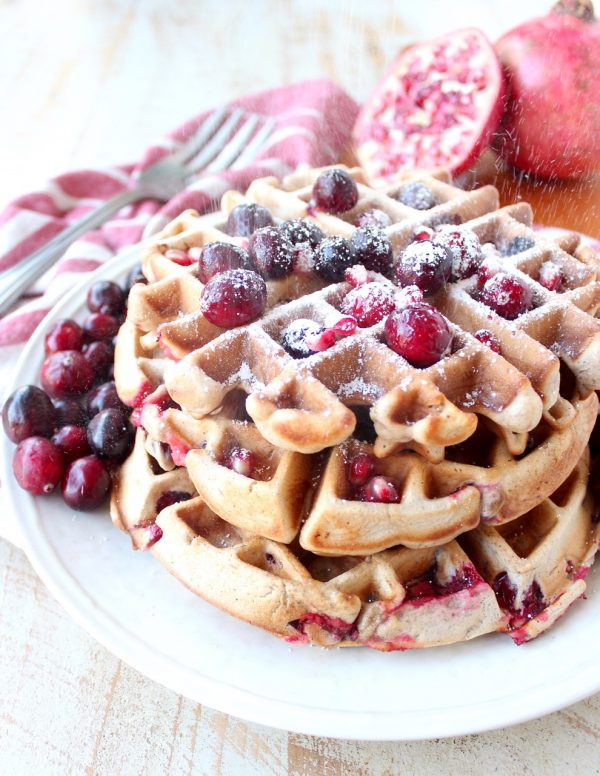 Fresh cranberries & pomegranates add a delicious burst of tartness & sweetness to this easy waffles recipe, perfect for fall breakfast or holiday brunch!