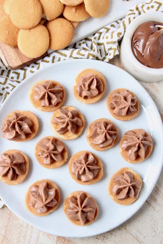 Overhead image of mini nutella cheesecake bites on plate