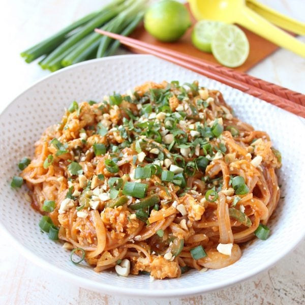 Spicy Vegetable Pad Thai Recipe topped with Green Onions, Peanuts and Cilantro