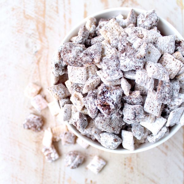 Chocolate is melted over rice chex cereal with Nutella hazelnut spread, then tossed with powdered sugar for delicious, gluten free Nutella Buddies!