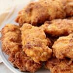 fried chicken tenders piled up on plate