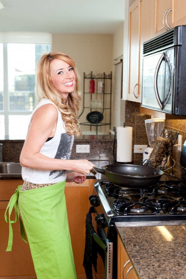 hot chef, photos of girls cooking, photos of cooking, images of cooking, woman cooking in kitchen, kitchen photo shoot, cooking photo shoot, world market apron, lime green apron, whitney bond, little leopard book, photo shoot, longaberger, flameware, skillet, girl cooking in kitchen