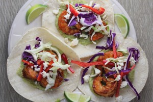 grilled shrimp tacos, chili lime shrimp tacos, shrimp tacos with green chili avocado sauce, avocado salsa, green chili avocado salsa, recipes, food, chili lime garlic shrimp, grilled shrimp, tacos, red pepper lime slaw