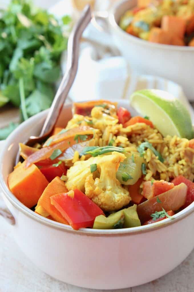 Vegetables and rice with curry sauce in bowl