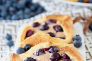"""blueberry pastry on cutting board with text overlay """"blueberry pastry recipe, quick & easy, made in 22 minutes with 6 ingredients!"""""""