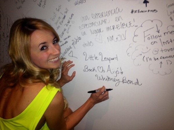 Whitney Bond signing the Aijo Brickell Signature Wall