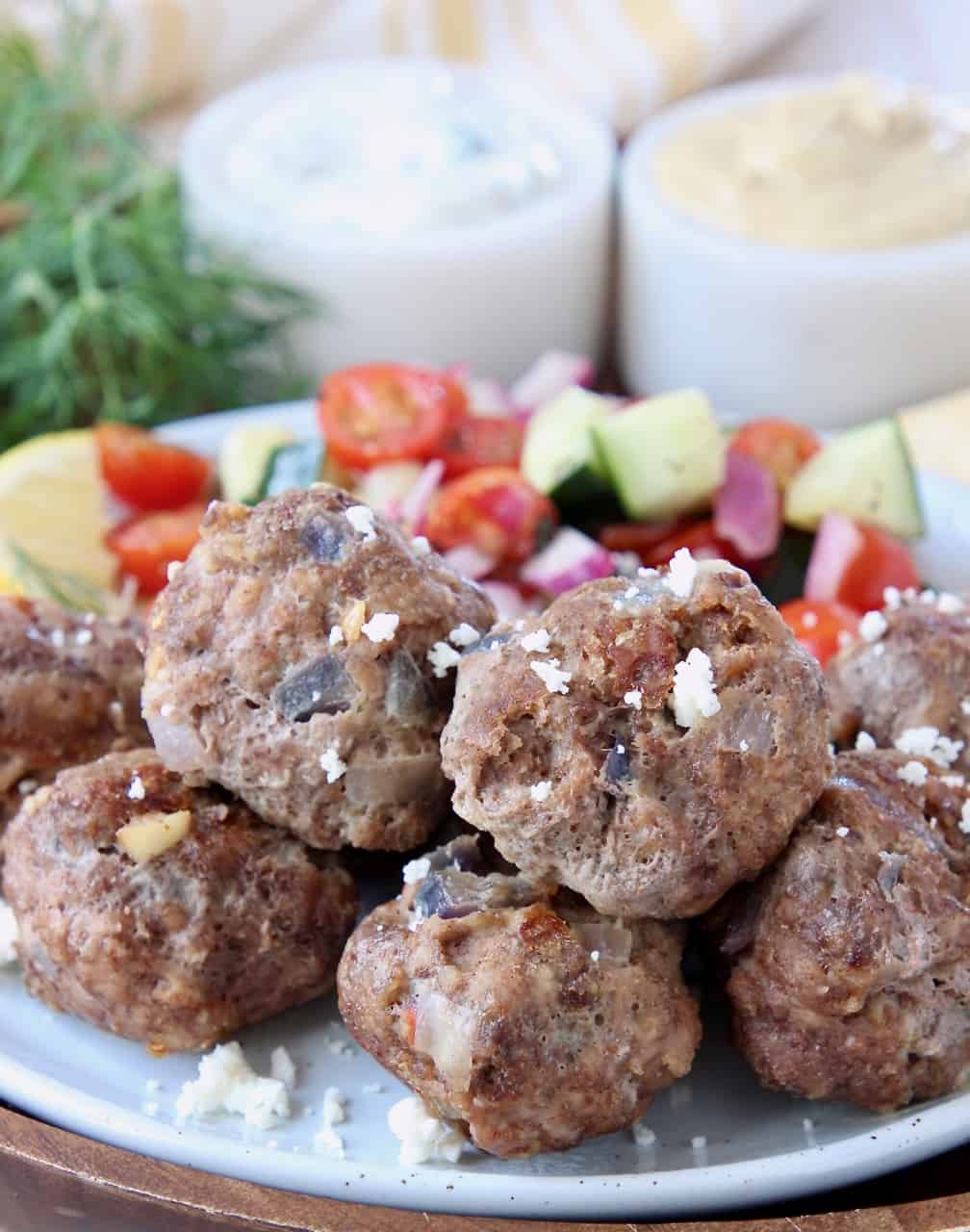 Greek meatballs on plate topped with crumbled feta cheese