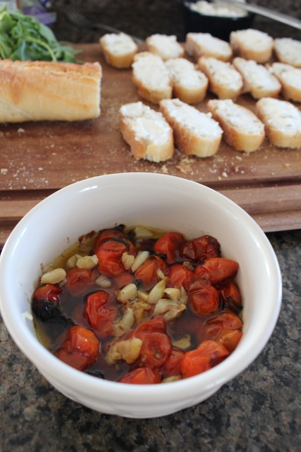 ... top each sliced baguette with the roasted tomatoes, garlic and sauce