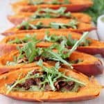 Sweet potato skins on wood serving tray