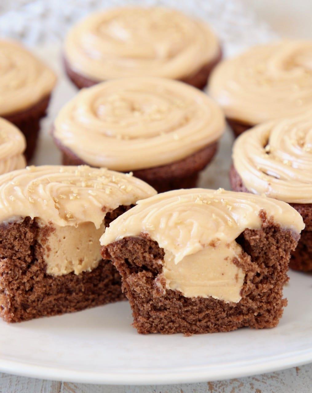 Peanut butter filled chocolate cupcake cut in half on plate