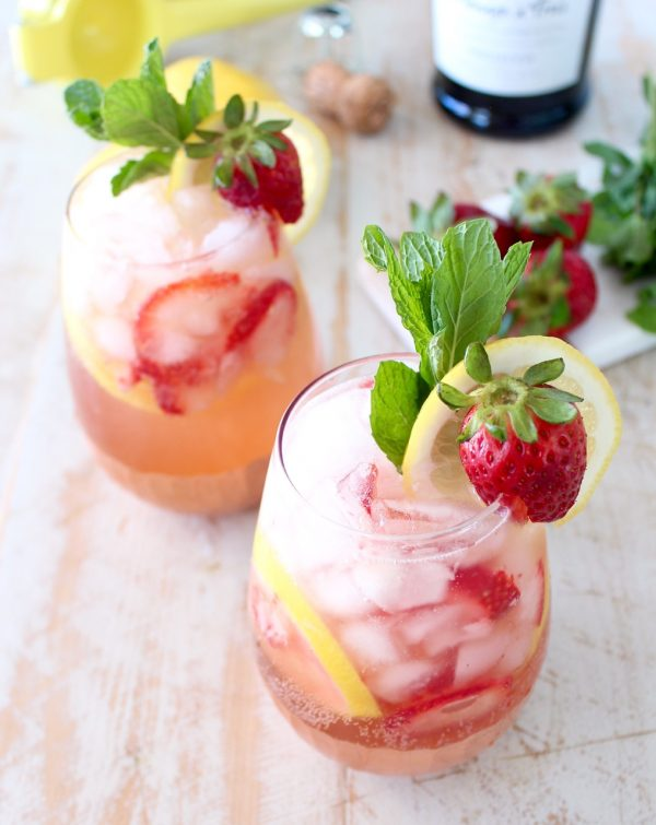 Fresh lemons and strawberries are mixed with bubbly prosecco for a refreshing prosecco sangria recipe that is perfect for spring and summer!