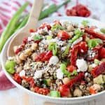 Quinoa salad in bowl with feta cheese, sun dried tomatoes and chickpeas
