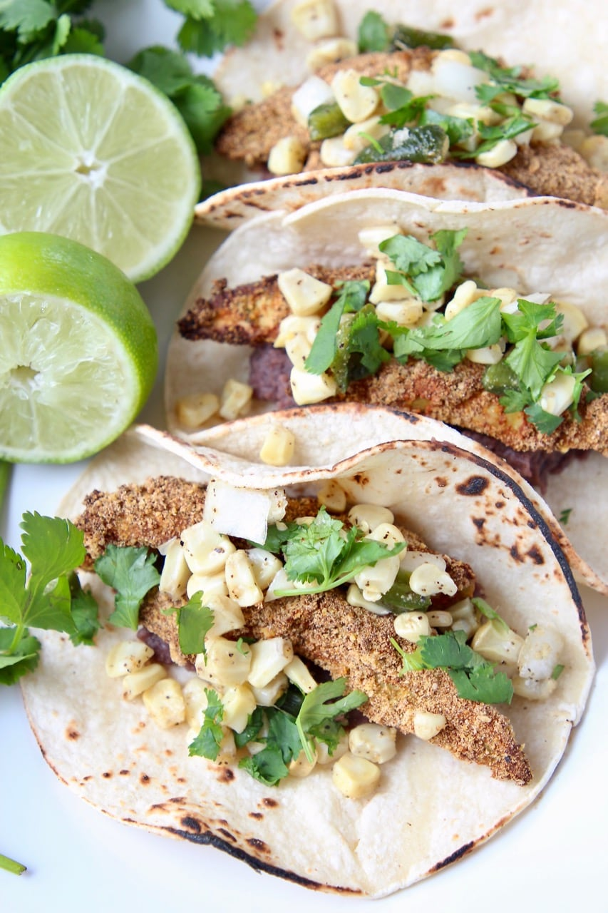 Overheat shot of crispy avocado tacos on plate with fresh cilantro