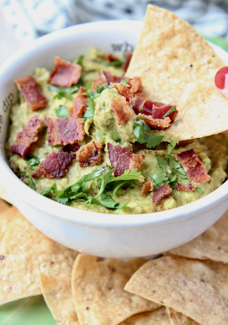 Chip dipped in bacon guacamole
