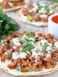 Grilled tortilla topped with buffalo sauce ground turkey and blue cheese