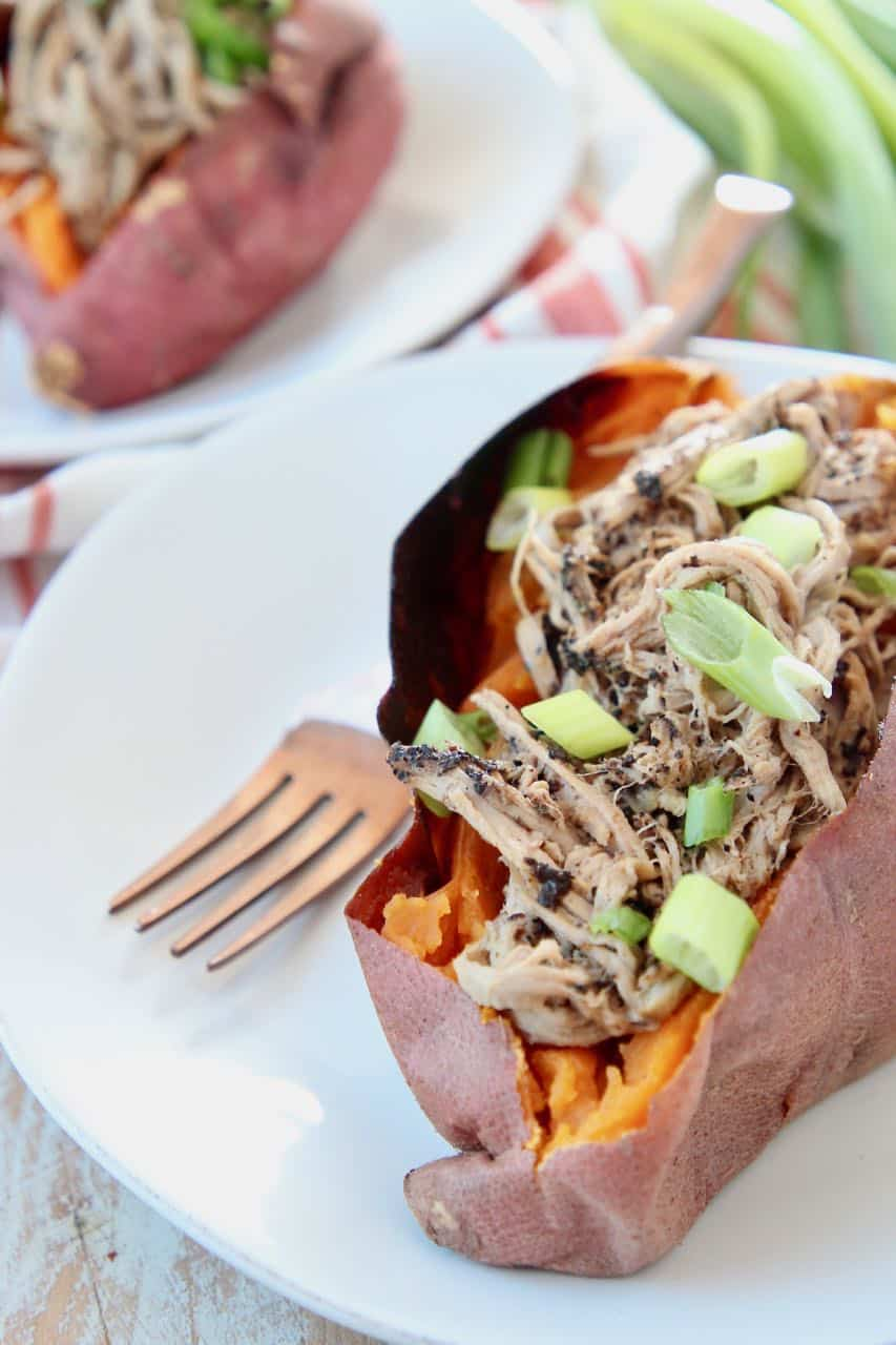 Pulled pork tenderloin in sweet potato topped with diced green onions