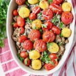 Turkey casserole topped with roasted cherry tomatoes