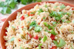 Mexican rice in orange bowl with fresh cilantro
