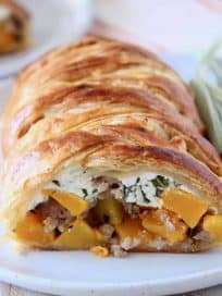 Puff pastry strudel cut open, filled with cubes of butternut squash and ricotta cheese