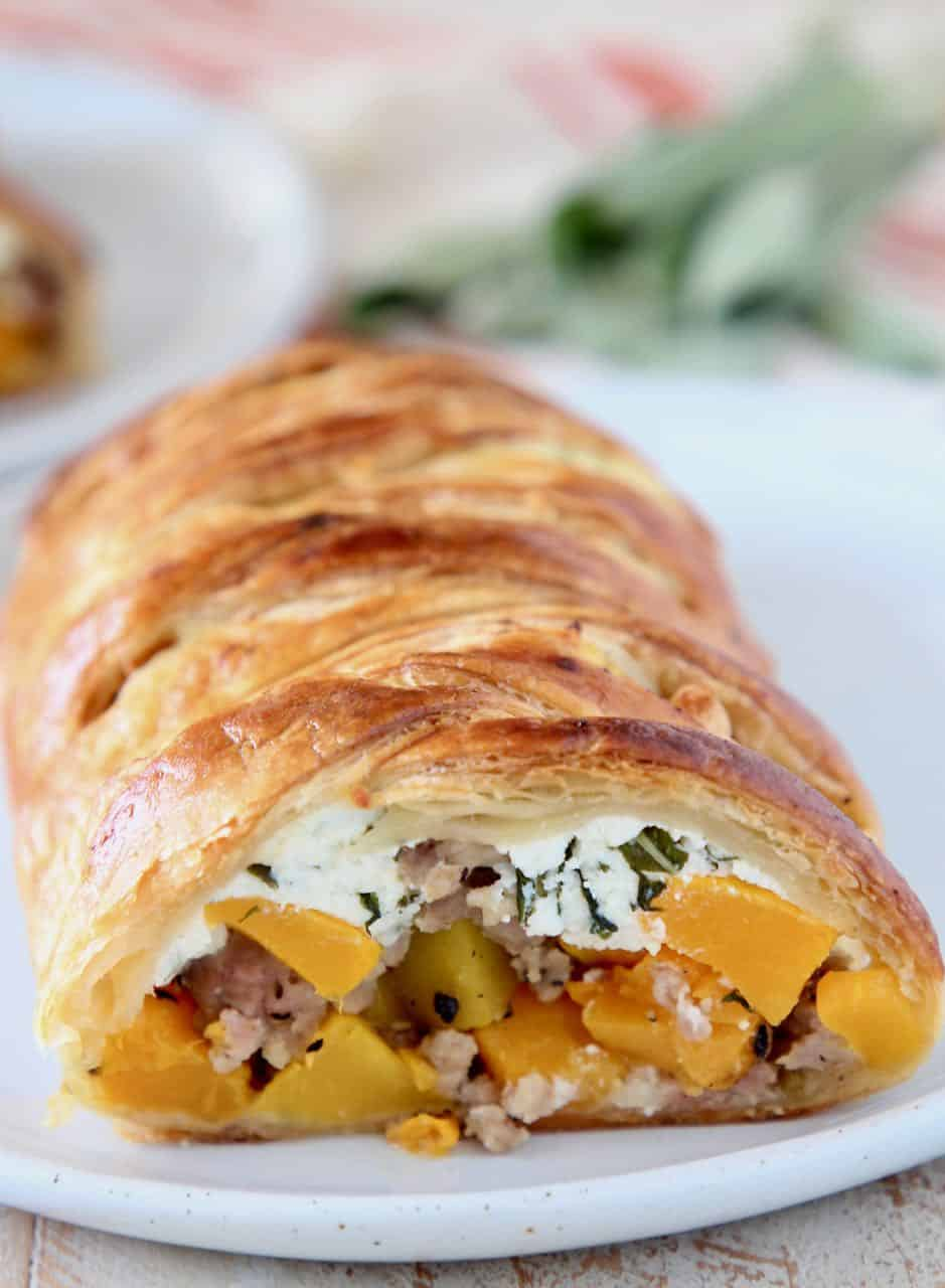 Strudel cut open, filled with butternut squash, sausage and ricotta cheese
