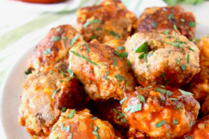 Sausage Balls with Buffalo Sauce Image with Text Overlay Buffalo Cheesy Sausage Balls Easy 4 Ingredient Crock Pot Recipe