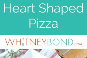 This heart shaped pizza is made with a homemade deep dish crust and filled with sweet Italian sausage, roasted red peppers, three cheeses & homemade sauce!