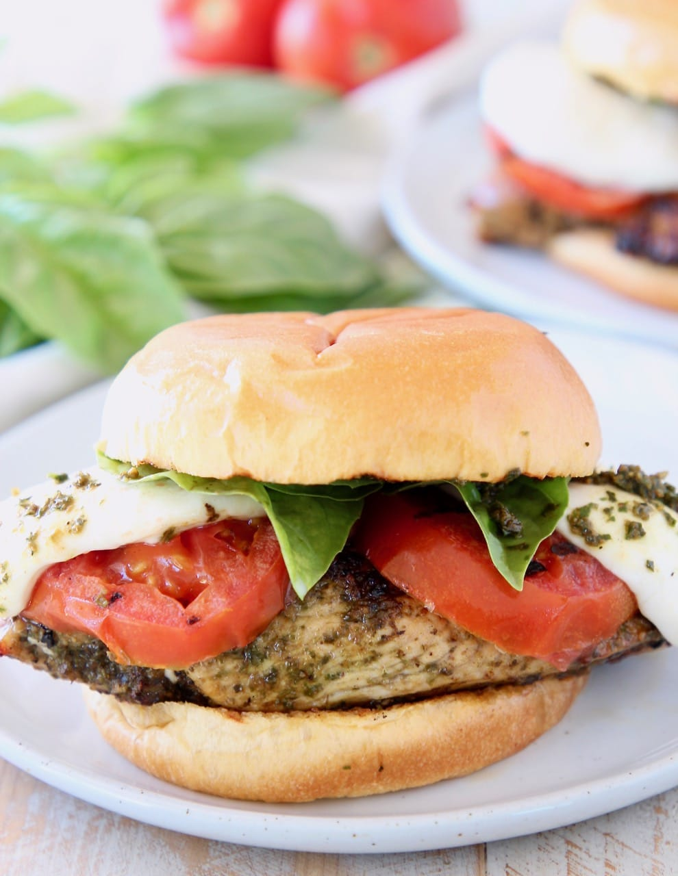 Pesto grilled chicken sandwich with grilled tomatoes and mozzarella cheese