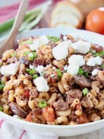 Ground lamb pasta in bowl with spoon