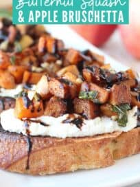 Roasted cubes of butternut squash on slices of bread with ricotta cheese