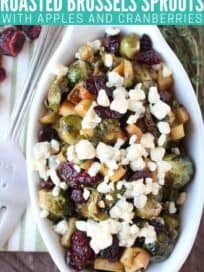 Overhead image of roasted brussels sprouts in bowl topped with gorgonzola cheese