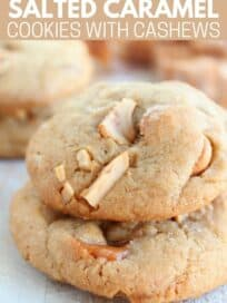 two salted caramel cashew cookies stacked on top of each other