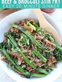 Ground beef and broccoli stir fry in bowl with serving spoon