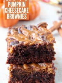 Pumpkin swirled brownies stacked up on top of each other