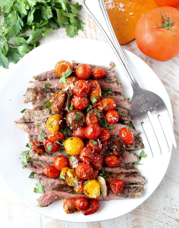In this delicious recipe, Italian seasoned flank steak is cooked in a cast iron skillet or sous vide, then topped with balsamic roasted cherry tomatoes.