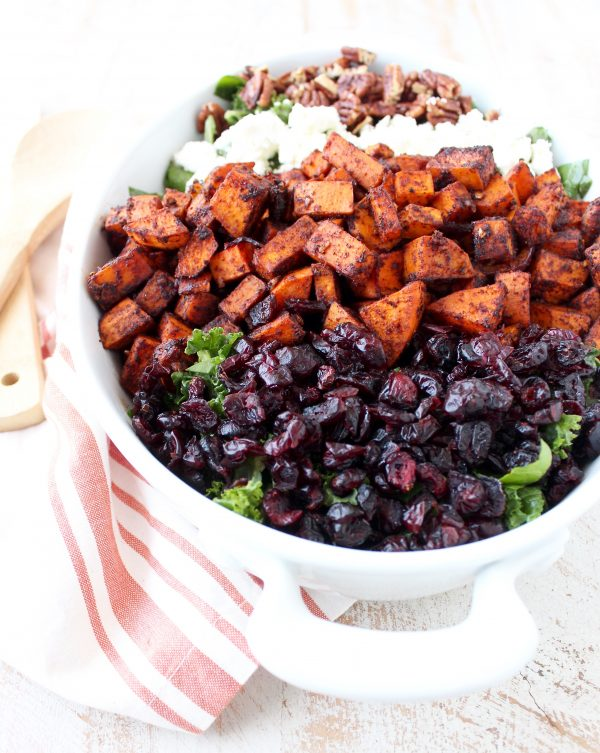 This Chili Roasted Sweet Potato & Cranberry Salad recipe combines sweet, savory & tart ingredients to make the most flavorful vegetarian salad ever!