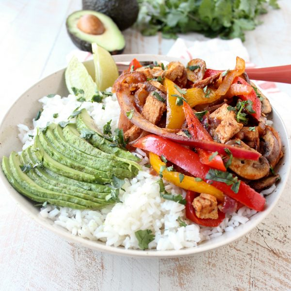 This turkey fajita rice bowl recipe is easy to make & the perfect use for leftover turkey at Thanksgiving, but makes a delicious meal anytime of the year!