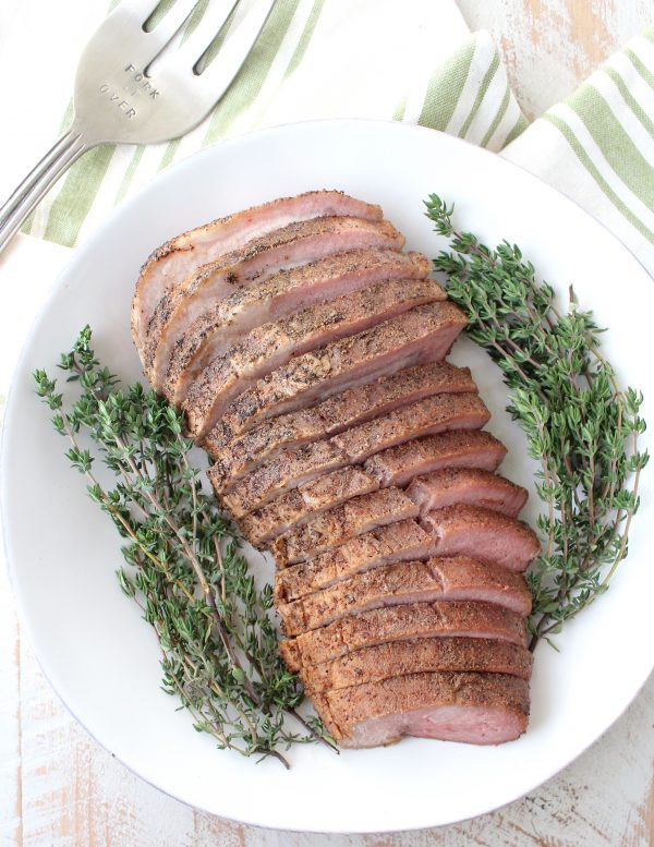 A boneless pork loin is cooked in a delicious combination of chipotle, nutmeg, cloves, maple syrup & apple juice in a sous vide or slow cooker.