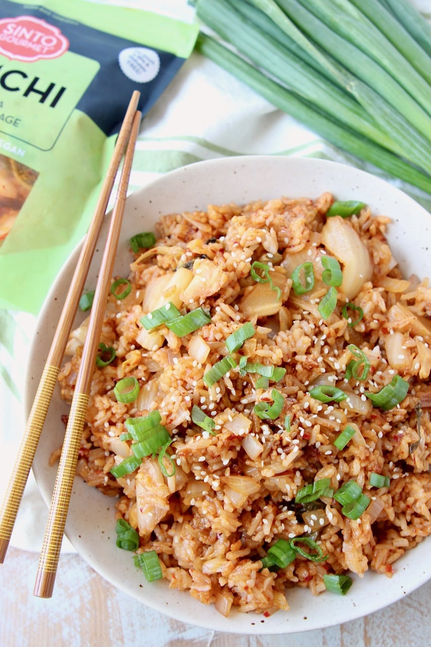 Overhead shot of Kimchi Fried Rice in bowl with chopsticks