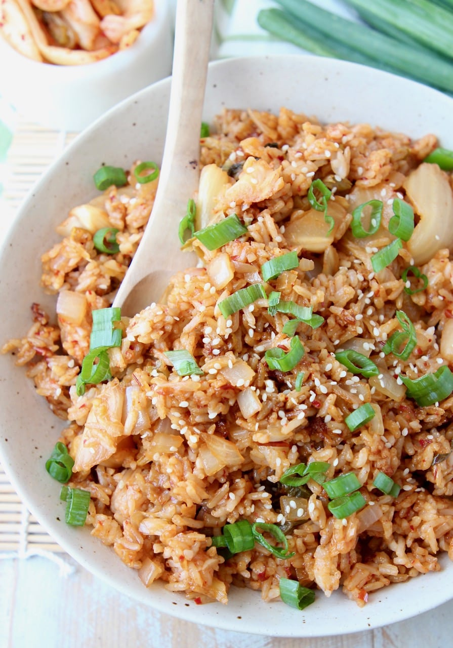 Overhead shot of kimchi fried rice in bowl with spoon